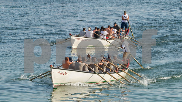 AMANDA SABGA/Staff photo<br /> <br /> The Nina bypasses the Santa Maria during men's seine boat race on Sunday at Gloucester's Pavilion Beach. <br /> <br /> 7/1/18