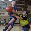 MIKE SPRINGER/Staff photo<br /> Eleven-year-old Charlie Amero of Gloucester goes up for a shot as Kiara Olson, 10, also of Gloucester, plays defense during a scrimmage Tuesday at the Cape Ann Basketball Camp at Rockport High School.<br /> 7/17/2018