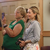 MIKE SPRINGER/Staff photo<br /> Children's librarian Jessica Furtado, right, and Alice Tierney watch during a retirement party Friday for Judy Gallerie on Friday at the Flint Public Library in  Middleton. Gallerie, the assistant director, is stepping down after 30 years of service at the library.<br /> 7/27/2018