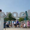 AMANDA SABGA/Staff photo<br /> <br /> Visitors bow their heads as Father Jim Achadinah, of Holy Family Church in Gloucester, says a prayer during the Blessing of the Fleet at the Fisherman's Memorial statue in Gloucester.<br /> <br /> <br /> 7/1/18