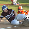 CARL RUSSO/staff photo. Gloucester's Bryan Swain is safe sliding into third base. Gloucester vs. Ipswich in Little League baseball action. 7/5/2018