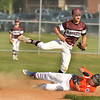 CARL RUSSO/staff photo. Gloucester's Emerson Marshall tags out Ipswich's Drew Lane at second base. Gloucester vs. Ipswich in Little League baseball action. 7/5/2018