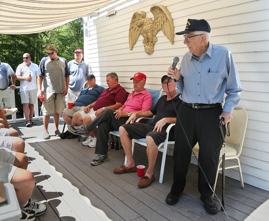 MIKE SPRINGER/Staff photo<br /> World War II veteran Michael Linquata, 91, speaks Monday at the VFW Post 1624 in Gloucester following the 2018 VFW Golf Open, which was held in his honor. Linquata was a 19-year-old Army combat medic in January of 1945, when he and 20 wounded men in his care were taken prisoner by the Germans during the Battle of the Bulge. He spent three months in a German prisoner of war camp before being liberated by advancing U.S. troops. He returned home to Gloucester, where he and his father established the Gloucester House restaurant.<br /> 7/9/2018