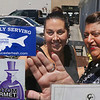 "MIKE SPRINGER/Staff photo<br /> Carla O'Connor, left, manager of Captain Carlo's Dockside Dining & Entertainment, and Mayor Sefatia Romeo Theken look at the ""Proudly Serving Gloucester Fresh Seafood"" sticker after Theken affixed it to the door Thursday to call attention to the restaurant's participation in the Gloucester Fresh program. In addition to Captain Carlo's, Theken also visited the Beauport Hotel and Machaca to thank them for their participation in the program.<br /> 7/19/2018"
