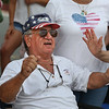 MIKE SPRINGER/Staff photo<br /> Peter Lafata enjoys the music Tuesday as he watches the 75th annual Fishtown Horribles Parade in Gloucester.<br /> 7/3/2018