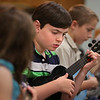 MIKE SPRINGER/Staff photo<br /> Eight-year-old Jude Northley learns to play chords during a ukulele workshop for children Thursday at the Sawyer Free Library in Gloucester.<br /> 7/19/2018