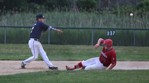MIKE SPRINGER/Staff photo<br /> Second baseman Eric Chalmers of the Manchester Essex Mariners throws to first base after forcing out Keady Segel of the Rockport Townies during ITL baseball action July 10 in Essex.<br /> 7/10/2018