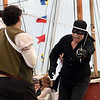 CARL RUSSO/staff photo. GLOUCESTER: Dread Pirate Robert Walsh, right, Artisitc director of the Swashbucklers of the Gloucester Harbour and pirate Robert Najarian engage in a sword fight. The Gloucester Stage Co. held their annual  2018 Gala on the Maritime Pier on Saturday (7/28) Dread Pirate (Artistic Director) Robert Walsh, enlisted an outstanding crew of swashbuckling performers to wow and immerse the audience with sword fights, sea songs, and a bit of rum. 7/28/2018