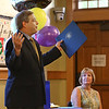 MIKE SPRINGER/Staff photo<br /> Judy Gallerie, assistant director of the Flint Public Library, listens as state Sen. Bruce Tarr speaks during her retirement party Friday in Middleton. Gallerie is stepping down after 30 years of service at the library.<br /> 7/27/2018