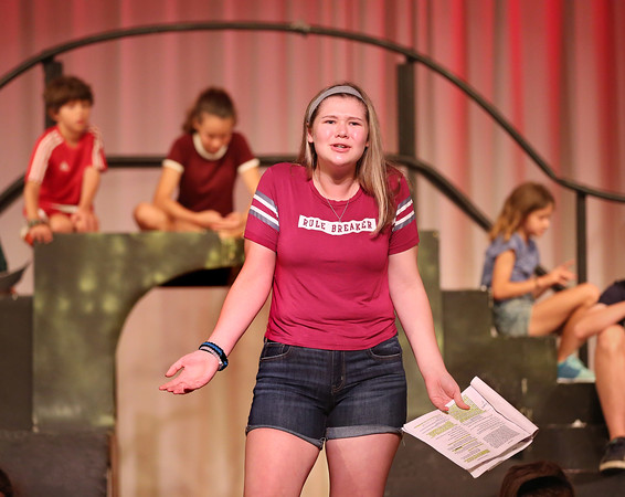 MIKE SPRINGER/Staff photo<br /> Eighth-grader Grace Topouzoglou rehearses a scene in the O'Maley Academy drama camp production. In the background, from left, are 3rd-grader Drew Ciolino, 7th-grader April Smith nd 5th-grader Skye Ciolino.<br /> 7/17/2018