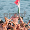 AMANDA SABGA/Staff photo<br /> <br /> Randy Sweet is carried out of the water after winning Sunday's greasy pole walk at  Pavilion Beach in Gloucester. <br /> <br /> 7/1/18