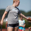 Ruby Melvin a Varsity Captain reaches out for a high five at the Gloucester High School Youth FIeld Hockey Camp, Tuesday, July 10, 2018. Jared Charney / Photo