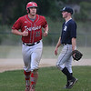 MIKE SPRINGER/Staff photo<br /> Rockport Townies Keady Segel runs back to the dugout during ITL baseball action July 10 against the Mariners in Essex.<br /> 7/10/2018