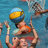 MIKE SPRINGER/Staff photo<br /> Nine-year-old John Wood of Gloucester plays water basketball Tuesday in the swimming pool at the Cape Ann YMCA's Camp Spindrift in Gloucester.<br /> About 250 children from around the area are enjoying a variety of summer activities at the camp.<br /> 7/10/2018