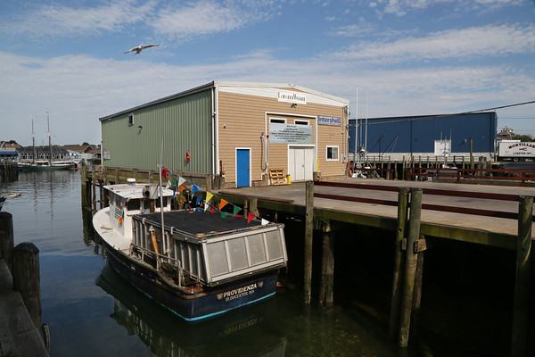MIKE SPRINGER/Staff photo<br /> A pier underneath which the body of a man was discovered Tuesday at Harbor Cove in Gloucester.<br /> 7/10/2018