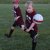 MIKE SPRINGER/Staff photo<br /> Eight-year-old Finn Brady kicks the ball as Brendan Smith, 7, looks on during the 7th-annual Cape Ann Soccer Camp Tuesday at Magnolia Woods in Gloucester. Eighty campers from four to 13 years of age have participated this summer.<br /> 7/31/2018