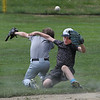 MIKE SPRINGER/Staff photo<br /> Jack Higgins, right, and Sam Simoes, both 8, collide in the outfield Wednesday during the Legends Baseball Youth Clinic at Wilson Field in Gloucester.<br /> 7/11/2018