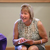 MIKE SPRINGER/Staff photo<br /> Judy Gallerie, assistant director of the Flint Public Library, opens a card during her retirement party Friday in Middleton. Gallerie is stepping down after 30 years of service at the library.<br /> 7/27/2018