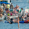 AMANDA SABGA/Staff photo<br /> <br /> Randy Sweet falls to the water after retrieving the flag during Sunday's greasy pole walk at Gloucester's Pavilion Beach. <br /> <br /> 7/1/18