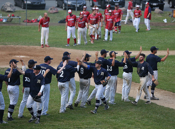 MIKE SPRINGER/Staff photo<br /> The Manchester Essex Mariners celebrate their victory over the Rockport Townies July 10 in Essex.<br /> 7/10/2018