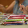 """MIKE SPRINGER/Staff photo<br /> A stack of """"Barefoot Contessa"""" books by Ina Garten at a meeting Tuesday of the """"Cook-a-Book"""" Cooking Club at the Sawyer Free Library.<br /> 7/11/2018"""