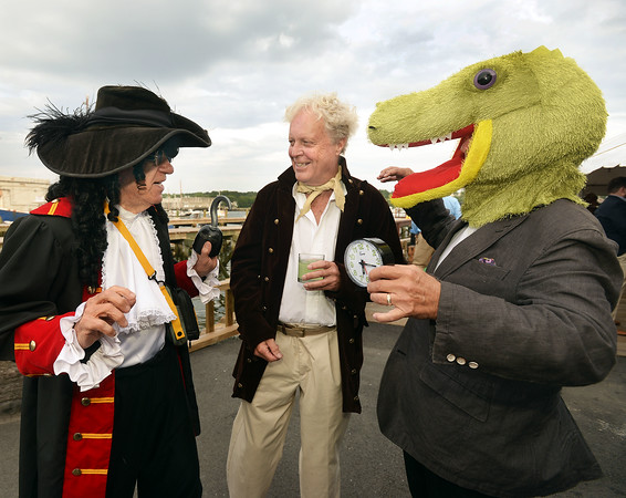 CARL RUSSO/staff photo. GLOUCESTER: Artist Geoff Chalmers, left, who is exhibiting at Charles Fine Arts Gallery, dressed as Captain Hook while Ted Charles, owner of Charles Fine Arts Gallery, came as Tick-Tock the Crocodile both characters from Peter Pan talked to William Taylor, a member of the The Gloucester Stage Co. Board of Directors. The Gloucester Stage Co. held their annual  2018 Gala on the Maritime Pier on Saturday (7/28) Dread Pirate (Artistic Director) Robert Walsh, enlisted an outstanding crew of swashbuckling performers to wow and immerse the audience with sword fights, sea songs, and a bit of rum. 7/28/2018
