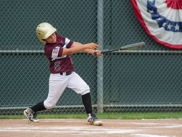 AMANDA SABGA/Staff photo<br /> <br /> Gloucester's Trey Mavrone (5) at bat during a game against Reading at Fernald Field in Wakefield. <br /> <br /> 7/14/18