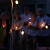 DAVID LE/Gloucester Times. Hundreds of people gathered on the Boulevard on Monday evening to celebrate and remember the lives of loved ones with a candlelight vigil.