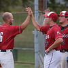 MIKE SPRINGER/Staff photo<br /> Mike Emerson, left, of the Rockport Townies receives a high five from teammates Kyle Nelson, center, and Jordan Pallazola after Emerson hit a home run July 10 against the Manchester Essex Mariners in Essex.<br /> 7/10/2018