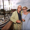 CARL RUSSO/staff photo. GLOUCESTER:  Jim and Liz Ayer of Marblehead enjoy the view while attending the gala. The Gloucester Stage Co. held their annual  2018 Gala on the Maritime Pier on Saturday (7/28) Dread Pirate (Artistic Director) Robert Walsh, enlisted an outstanding crew of swashbuckling performers to wow and immerse the audience with sword fights, sea songs, and a bit of rum. 7/28/2018