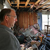 "MIKE SPRINGER/Staff photo<br /> Owner Alan Battistelli looks Monday at a fire-damaged room on the second floor of the Cape Hedge Inn in Rockport. The inn was badly damaged Sunday in an early morning fire. Battistelli expressed relief that all of his tenants escaped the fire. ""Buildings can be replaced,"" he said, "" but people can't.""<br /> 7/30/2018"