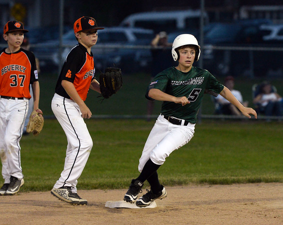 CARL RUSSO/staff photo. Manchester Essex's Michael Deoreo rounds second base and looks to third. He was tagged out sliding into third base. Beverly defeated Manchester Essex in Little League baseball action Thursday night. 7/5/2018
