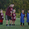 MIKE SPRINGER/Staff photo<br /> Coach Armando Marnoto leads a group of youngsters in the 7th-annual Cape Ann Soccer Camp Tuesday at Magnolia Woods in Gloucester. Listening, from left, are Angelo Robertson, 7, Willow Manning, 7, Jack Baillie, 7, and Kyle Silva, 6. Eighty campers from four to 13 years of age have participated this summer.<br /> 7/31/2018
