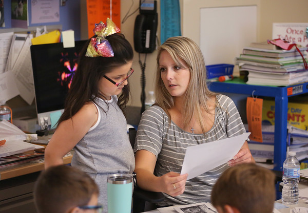MIKE SPRINGER/Staff photo<br /> Teacher McKayla Catto talks with third-grader Arianna Marshall during a Cape Ann YMCA summer reading class Friday at West Parish Elementary School in Gloucester.<br /> 7/20/2018