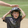 MIKE SPRINGER/Staff photo<br /> Dante Holding, 5, receives a pat on the head after hitting a base run Wednesday at the Legends Baseball Youth Clinic at Wilson Field in Gloucester.<br /> 7/11/2018