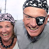 CARL RUSSO/staff photo. GLOUCESTER: Larry and Barby Maver of Gloucester give a hearty ''arrrrggghhhh matey'' while attending the gala as pirates. Larry is tresasurer of the The Gloucester Stage Co. Board of Directors. The Gloucester Stage Co. held their annual  2018 Gala on the Maritime Pier on Saturday (7/28) Dread Pirate (Artistic Director) Robert Walsh, enlisted an outstanding crew of swashbuckling performers to wow and immerse the audience with sword fights, sea songs, and a bit of rum. 7/28/2018