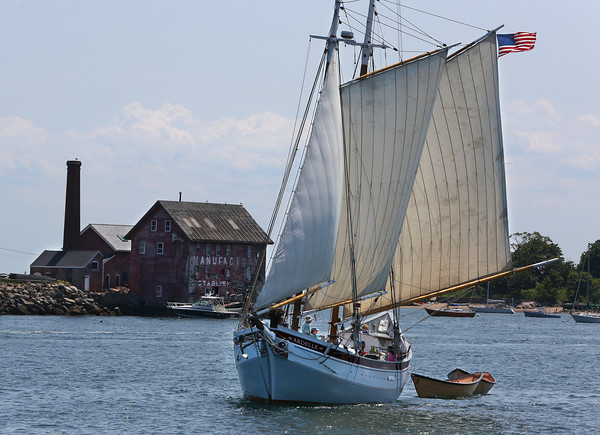 MIKE SPRINGER/Staff photo<br /> The schooner Ardelle, with 15 children from the Maritime Gloucester Coastal Explorers group onboard, pulls a pair of student-built dories into Gloucester Harbor Friday afternoon. One of the fishing dories was built this year at the Essex Shipbuilding museum by students from the Northshore Education Consortium's Topsfield Vocational Academy, and the other was built earlier by apprentices at Lowell's Boat Shop in Amesbury.  The campers from the Coastal Explorers were treated Friday to a trip up the Essex River on the Ardelle to visit the shipbuilding museum and bring the dories back to Gloucester, where they will be used on the schooner Adventure.<br /> 7/13/2018