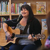 MIKE SPRINGER/Staff photo<br /> Musician Charlie Hope of Seattle, Washington, performs Wednesday in the children's room of the Manchester Public Library.<br /> 7/11/2018