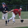 MIKE SPRINGER/Staff photo<br /> Rockport Townies shortstop Dylan Maki fields a ball as Kellen Field of the Manchester Essex Mariners runs to second base during ITL baseball action July 10 in Essex.<br /> 7/10/2018