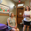 MIKE SPRINGER/Staff photo<br /> Judy Gallerie, left, assistant director of the Flint Public Library, listens as Melissa Stankus, chair of the library board of trustees, presents her with a gift during her retirement party Friday in Middleton. Gallerie is stepping down after 30 years of service at the library.<br /> 7/27/2018