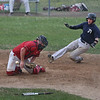 MIKE SPRINGER/Staff photo<br /> Rory Gentile of the Manchester Essex Mariners slides into home plate as the ball slips away from Rockport Townies catcher Caleb Tanson during ITL baseball action July 10 in Essex.<br /> 7/10/2018