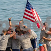 AMANDA SABGA/Staff photo<br /> <br /> Rowers on the Nina celebrates after winning men's seine boat race on Sunday at Gloucester's Pavilion Beach. <br /> <br /> 7/1/18