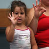 HADLEY GREEN/Staff photo<br /> Chiara Oliva, 5, of Gloucester, signs during the Singing and Signing event at the Sawyer Free Library.<br /> <br /> 07/05/2018