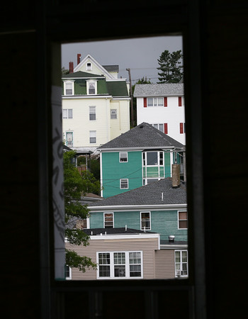 HADLEY GREEN/Staff photo<br /> Houses are seen through a paneless window on the top floor of the new GMGI building on the Gloucester waterfront. <br /> <br /> 07/05/2018