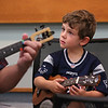 MIKE SPRINGER/Staff photo<br /> Five-year-old Perry Ramsden listens to instructor Don Rovero of South Hadley during a ukulele workshop for children Thursday at the Sawyer Free Library in Gloucester.<br /> 7/19/2018
