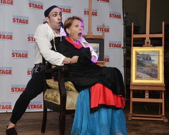 CARL RUSSO/staff photo. GLOUCESTER: Pirate Scott Caron, Directing Apprentice for The Gloucester Stage Co. kidnaps Lindsay Crouse, an Acadamy Award-nominated actress and stage performer and holds her for ransom as part of the perfomance during the live auction. The Gloucester Stage Co. held its annual 2018 Gala on the Maritime Pier on Saturday (7/28) Dread Pirate (Artistic Director) Robert Walsh, enlisted an outstanding crew of swashbuckling performers to wow and immerse the audience with sword fights, sea songs, and a bit of rum. 7/28/2018