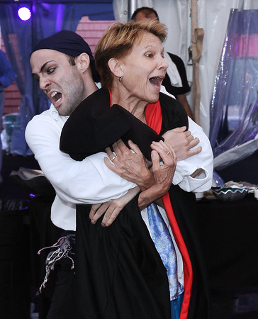 CARL RUSSO/staff photo. GLOUCESTER: Pirate Scott Caron, Directing Apprentice for The Gloucester Stage Co. kidnaps Lindsay Crouse, an Acadamy Award-nominated actress and stage performer and holds her for ransom as part of the perfomance to raise money during the live auction. The Gloucester Stage Co. held its annual 2018 Gala on the Maritime Pier on Saturday (7/28) Dread Pirate (Artistic Director) Robert Walsh, enlisted an outstanding crew of swashbuckling performers to wow and immerse the audience with sword fights, sea songs, and a bit of rum. 7/28/2018