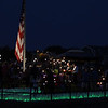 DAVID LE/Gloucester Times. Hundreds of people gathered on the Boulevard to celebrate and remember the lives of loved ones during an annual Vigil. Bags lit up carried names of people lost.