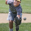 MIKE SPRINGER/Staff photo<br /> Nine-year-old Sam Young fields a ball Wednesday during the Legends Baseball Youth Clinic at Wilson Field in Gloucester.<br /> 7/11/2018