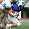 Manchester-Essex running back Christian Dumont plows ahead for a few extra yards while playing against the South in the 53rd Agganis Football game on Thursday evening at Manning Field in Lynn. DAVID LE/Staff photo. 6/26/14.